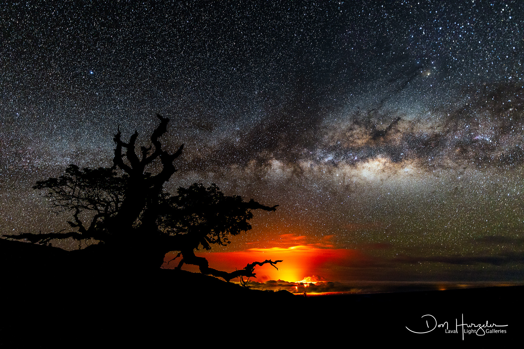 Taken maybe 30 miles away at 8500 feet up Mauna Kea...Milky Way over the Puna eruption.