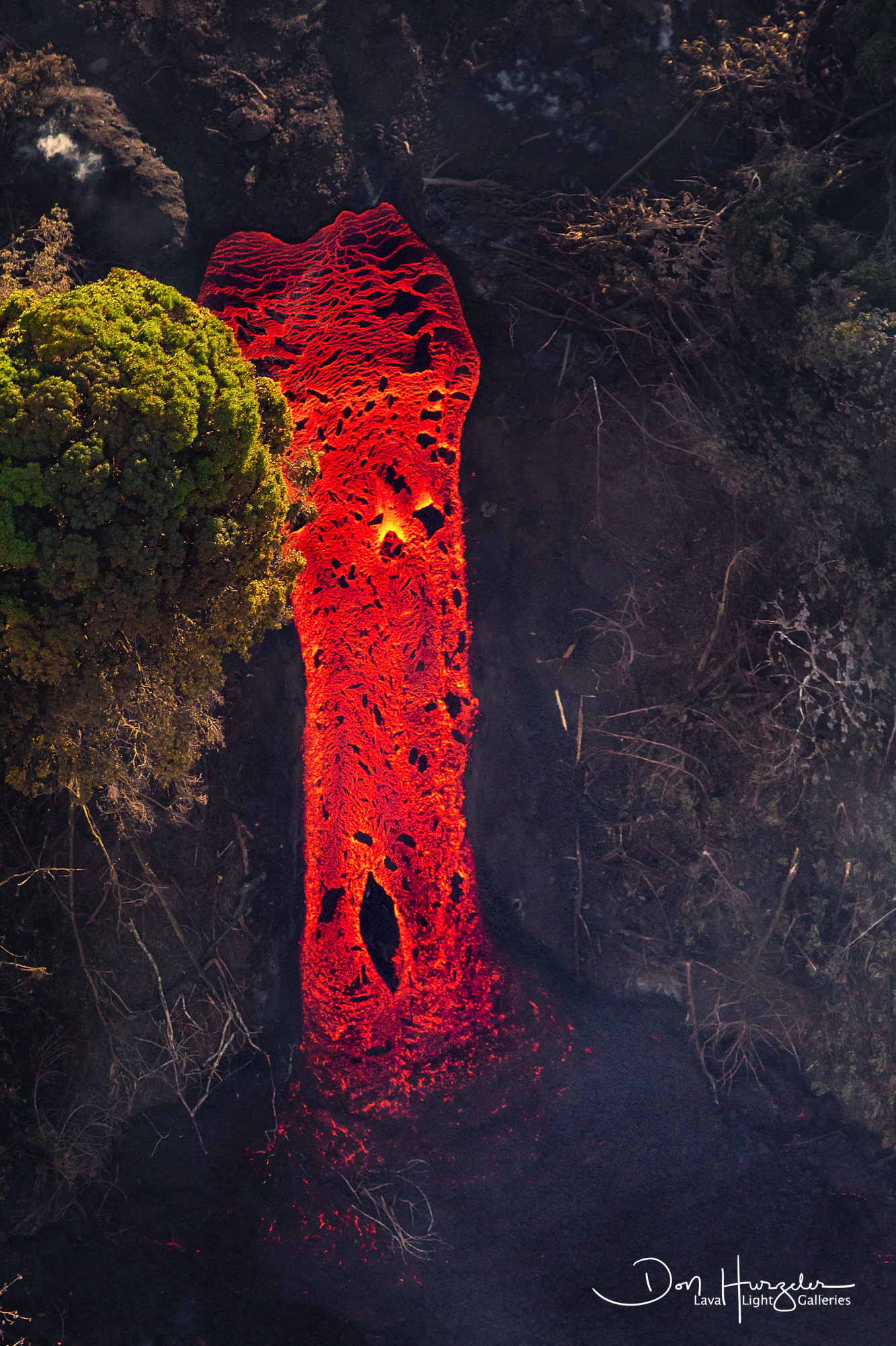 """This is the famous """"Lava Waterfall"""" taken from 3000 feet up with a 600mm lens from a helicopter over Green Lake, Hawaii. Estimated..."""