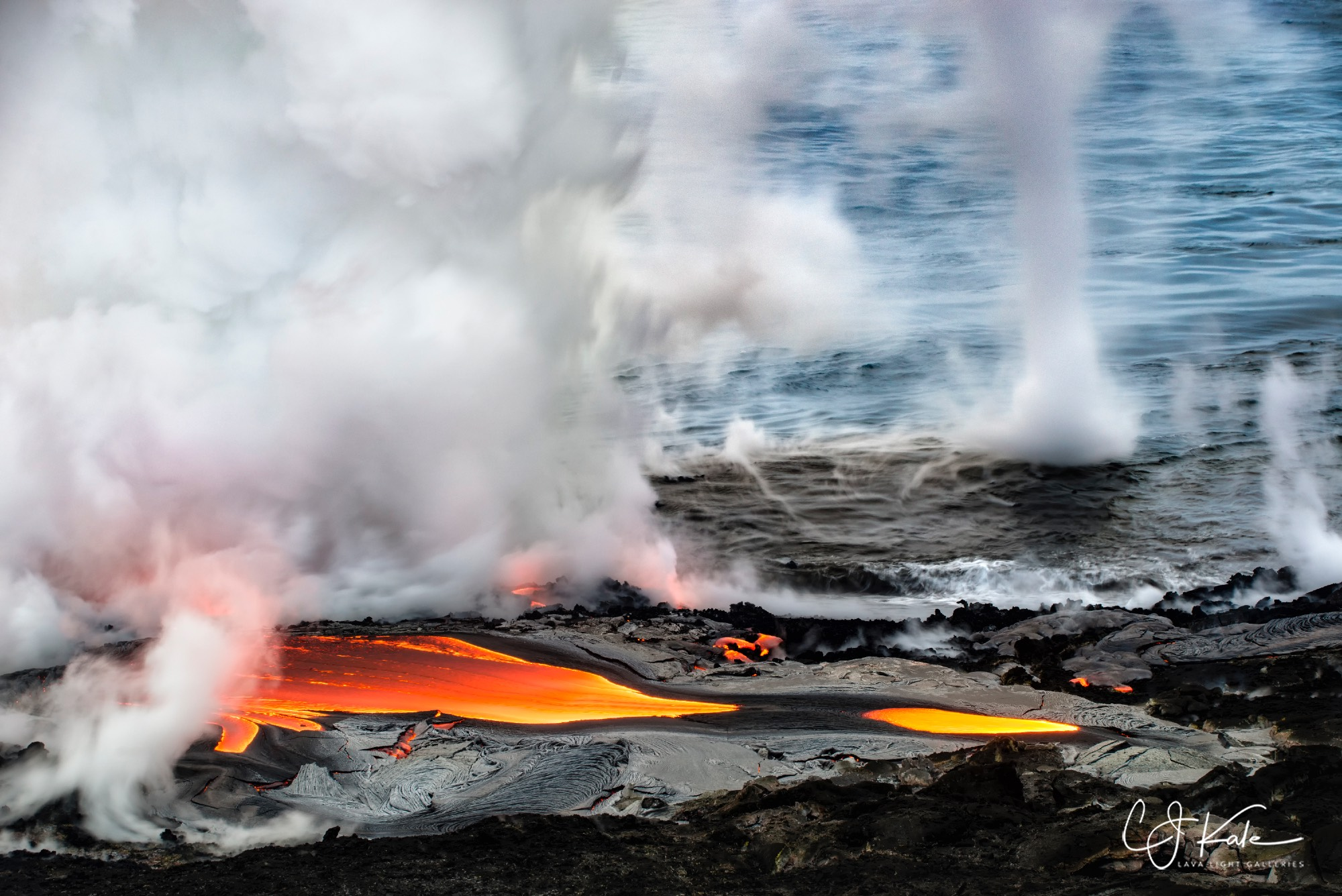 The hot lava hitting the much cooler ocean often causes little tornado like vortices.
